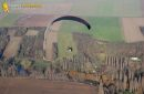Paramotor flying over the Seine at Mantes-la-Jolie  seen from the sky