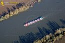 Barge on the Seine river seen from the sky at Haute-Isle en Vexin in Val de Seine